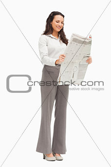 Smiling employee reading the news