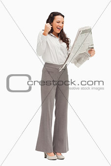 Enthusiastic employee reading the news