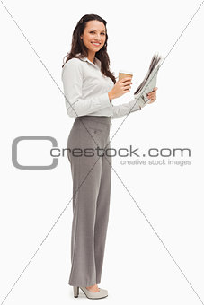 Portrait of an employee with a newspaper and a coffee