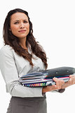 Portrait of a brunette carrying heavy files