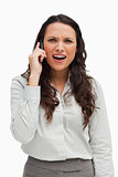 Close-up of a brunette grimacing while calling