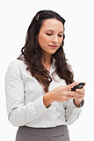 Close-up of a brunette texting
