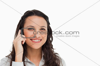 Portrait of a smiling brunette making a call