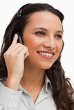 Close-up of a brunette smiling while calling