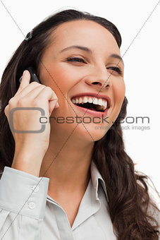 Close-up of a brunette beaming while calling