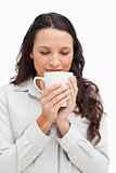 Brunette smelling a tea