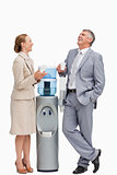 People laughing next to the water dispenser
