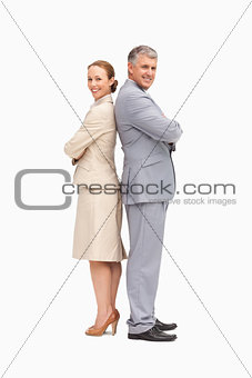 Portrait of smiling business people back to back