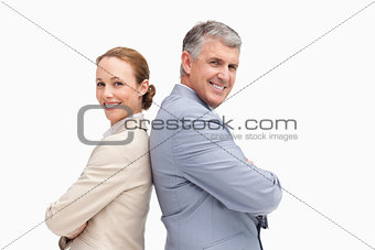 Portrait of happy business people back to back