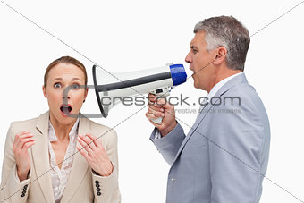 Businessman using a megaphone after his colleague
