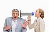 Businesswoman using a megaphone after her colleague
