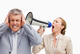 Businesswoman screaming with a megaphone after her colleague