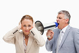 Businessman yelling with a megaphone after his colleague