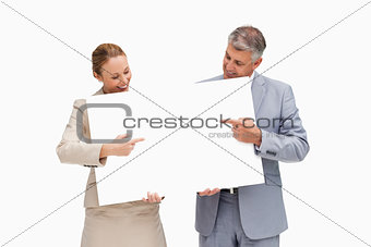 Business people holding and pointing a poster