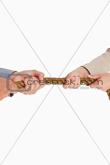 Business people pulling the rope