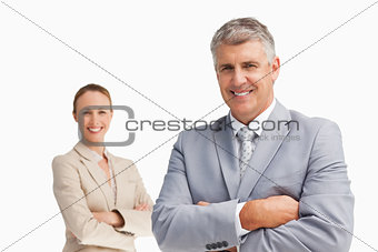 Smiling business people with folded arms