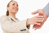 Low angle-shot of a woman shaking hands