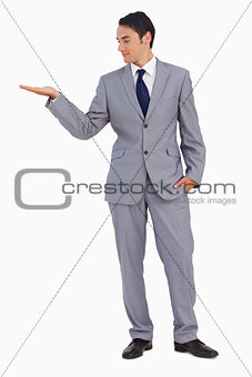 Good-looking man presenting with the hand