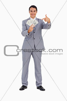 Portrait of a good-looking man showing a lot of dollars