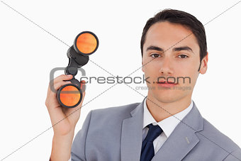 Close-up of a handsome businessman with binoculars