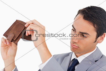 Man in a suit with his wallet empty 