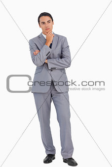 Thoughtful businessman with folded arms