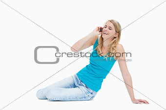 A smiling woman is talking on her mobile phone
