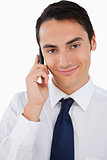 Close-up of a handsome man calling with his cellphone