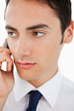 Close-up of a man in a suit calling with his cellphone