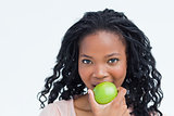 Head shot of a woman eating an apple
