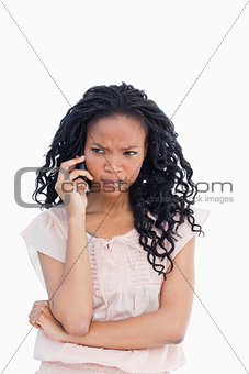 An angry woman talking on her mobile phone