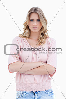 Woman staring at the camera with her arms folded