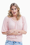 Woman with a shocked expression on her face has her arms crossed