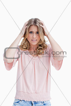 Frustrated woman has her hands held up to her head