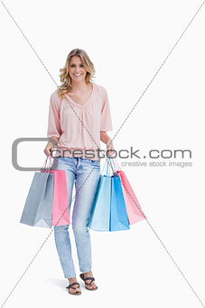 Full length shot of a woman carrying shopping bags