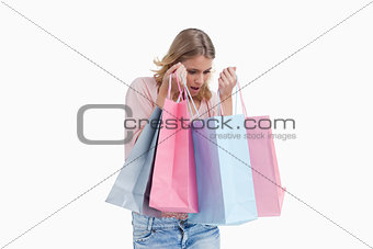 A woman is carrying shopping bags