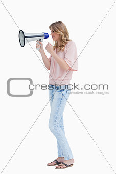 Serious young woman holding a megaphone