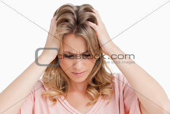 Angry young woman placing her hands on her head