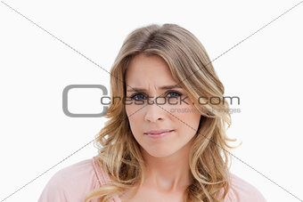 Serious young blonde woman looking at the camera