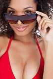 Attractive brunette woman looking over her sunglasses