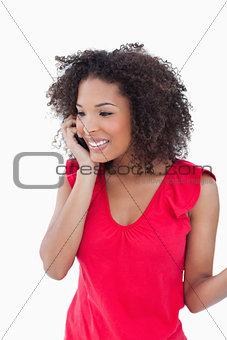 Smiling brunette using her cellphone