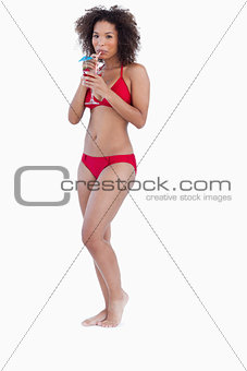 Attractive woman holding a cocktail