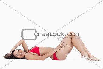 Smiling brunette woman lying down