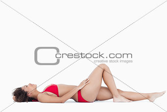 Attractive woman in swimsuit lying down