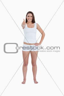 Happy brunette woman putting her thumbs up