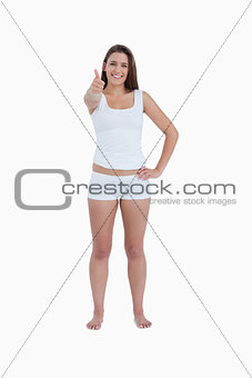 Brunette woman putting her thumbs up