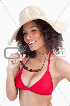 Attractive brunette woman holding her sunglasses