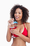 Attractive brunette holding a fruit cocktail