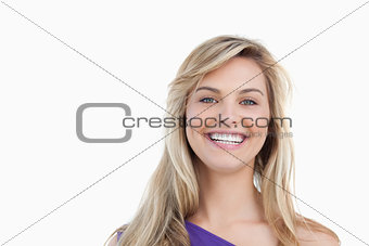 Smiling blonde woman looking at the camera