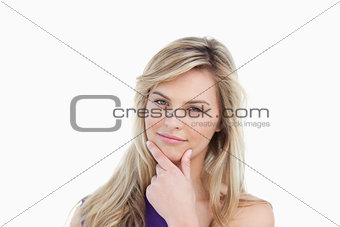 Thoughtful young woman placing her fingers on her chin